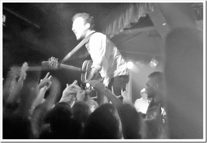 Black and white photo of Frank Turner in concert at The Corner Hotel in Richmond, Melbourne.